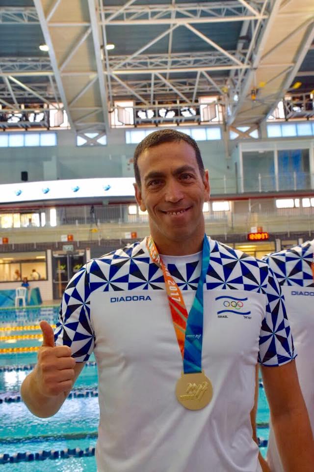 אריק קוטק - מאמן שחייה